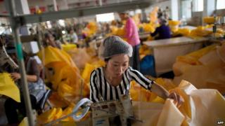 Factory workers outside of Beijing