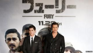 """Cast members Brad Pitt (R) and Logan Lerman pose for pictures on the red carpet for the Japan premiere of the movie """"Fury"""" in Tokyo"""