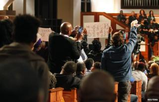 """Protesters disrupt speech in Ebenezer Baptist Church during a forum titled """"The Community Speaks"""" in Atlanta, Georgia December 1, 2014"""