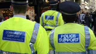 The back of a police community support officer