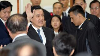 Taiwan President Ma Ying-jeou waves to his ruling Kuomintang (KMT) party colleagues after resigning as chairman in Taipei on December 3