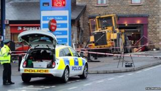 Digger rammed into cash machine