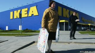 A woman and a man standing outside a Polish Ikea store