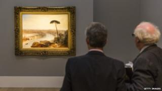 Two men looking at the painting at Sotheby's in November
