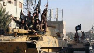 Islamic State militants drive a tank through Raqqa, Syria (undated image)