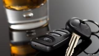Car keys and glass containing alcohol