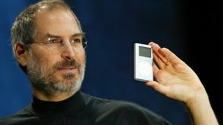 Steve Jobs holding a mini iPod