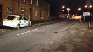 Police car outside St Denys house