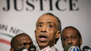 Civil rights activist Al Sharpton (centre) appeared in New York on 4 December 2014