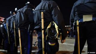 Police in riot gear line up against protesters in Ferguson, Missouri, on November 25, 2014