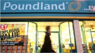 A man walks past a Poundland store