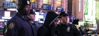 Police arrest a demonstrator at a protest over the death of Eric Garner in New York, 4 December