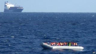 Migrants aboard boat, in image released by Italian navy on 4 December 2014