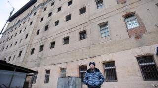 A guard standing outside a Russian prison
