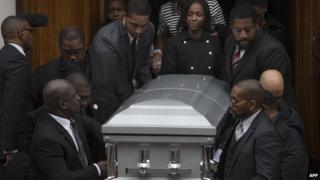 Kimberly Michelle Ballinger, the domestic partner of Akai Gurley, center right, exits Brown Baptist Church during the funeral for Gurley, Saturday, Dec. 6, 2014