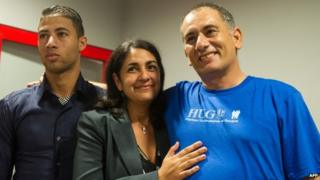 Felix Baez, right, with wife Vania Ferrer and his son Alejandro at the Jose Marti International Airport in Havana. 6 Dec 2014