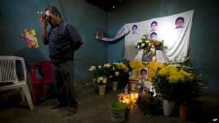 Ezequiel Mora stands next to an altar in his son's memory on 7 December, 2014