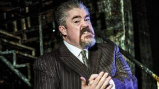Phill Jupitus as he appears in West End musical Urinetown