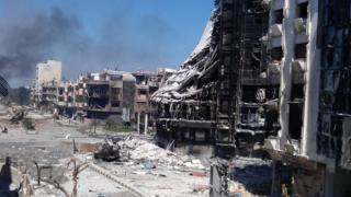 Badly damaged buildings in Homs, Syria