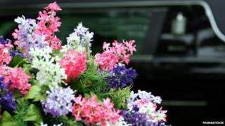 Hearse and flowers