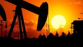 Oil well at sunset