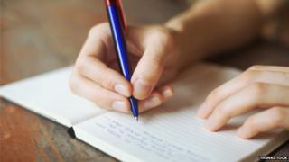 writing in a notebook
