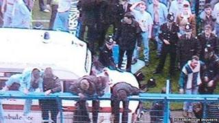 People climbing on the fences at Hillsborough