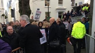 Protestors outside the Guernsey States building