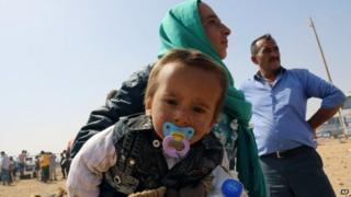 Syrian refugees enter Turkey at Yumurtalik crossing gate near Suruc, Turkey,