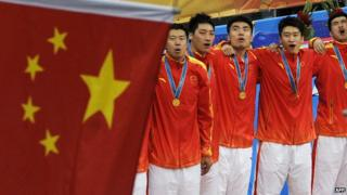 Gold medallists from China sing the national anthem during the award ceremony for the men's basketball gold medal match at the 16th Asian Games in Guangzhou on November, 2010.