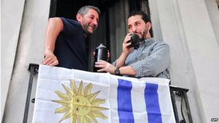 "Former Guantanamo prison inmate Syrian Jihad Ahmed Mustafa Diyab (R)with an unidentified union member in a house provided by national labour union federation PIT-CNT in Montevideo on December 11, 2014 is seen drinking ""mate"""