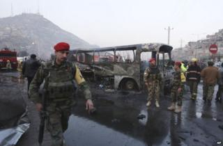 Soldiers secure the scene of the bus attack in Kabul, 13 December