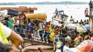 Library picture showing people arriving on in DR Congo a crowded boat from neighbouring Congo Brazzaville, in April 2014.