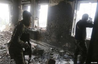 Rebel fighters in Aleppo, 7 December