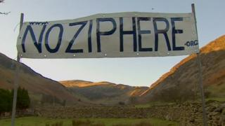 Banner protesting against the proposed zip wire