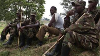 Members of the former Congolese M23 rebels sit at a compound in Uganda's Bihanga Training School, about 380km south-west of the capital Kampala, on 7 February 2014