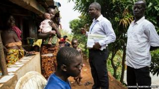 A disease surveillance officer working for Operation Western Area Surge visits a family in Moyinba, Sierra Leone