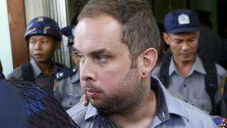 New Zealand citizen Philip Blackwood is escorted by policemen after a hearing at a court, Yangon, Myanmar