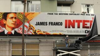 A billboard for Sony's The Interview is taken down.