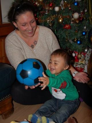 Samantha and baby and Christmas tree