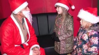 One of the Santa's seeing two children