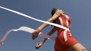 Female athlete crosses finishing line