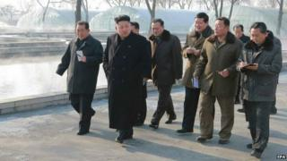 Undated photo of North Korean leader Kim Jong-un visiting a catfish farm