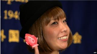 "This file picture taken on 24 July 2014 shows Japanese artist Megumi Igarashi showing a small mascot shaped like a vagina ""Manko-chan"" at a news conference in Tokyo."