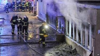Firemen outside the mosque in Eskilstuna, Sweden, that was set alight - 25 December 2014
