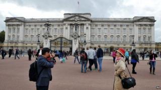 File photo dated 20/10/2014 of tourists taking a photograph outside Buckingham Palace