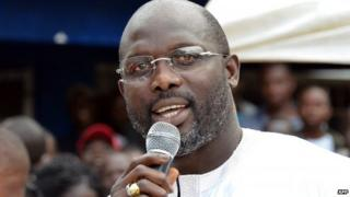 George Weah speaking at a campaign rally in Liberia