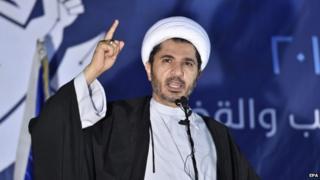 Sheikh Ali Salman (L), secretary general of the leading opposition grouping Al-Wefaq, speaks during Al-Wefaq general assembly meeting in Karanah village north of the Bahraini capital Manama, 26 December 2014