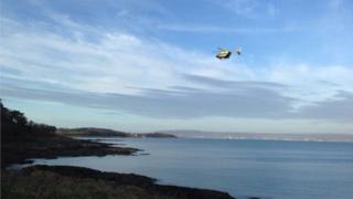 helicopter searches along the County Down coast for missing swimmer