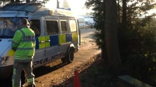 Fire officer and police van